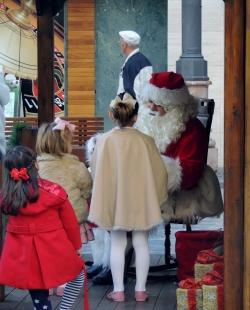 XMas wish list sign off queue with Santa Claus