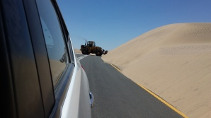 Sand removal from highway